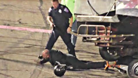 race car driver tased by police after someone drives on top of his