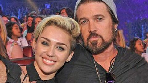 Miley Cyrus Crashes Billy Ray's Interview To Reveal Her New Boyfriend | Country Music Videos
