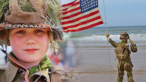 11-Year-Old Salutes For Over An Hour On Omaha Beach While Trumpeter Plays 'Taps' In 2014 | Country Music Videos