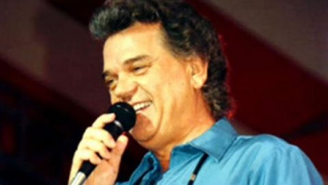 Conway Twitty – Between Her Blue Eyes And Jeans   Country Music Videos