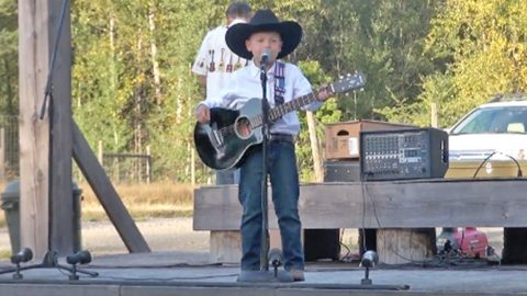 Little George Strait Fan Wows Crowd With Spot-On 'Check Yes Or No' Performance | Country Music Videos
