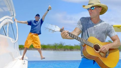 """Kenny Chesney Goes On Everyone's Dream Vacation In New Music Video For """"Save It For A Rainy Day"""" (WATCH) 