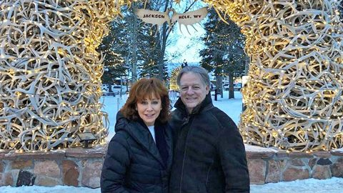 Reba Cozies Up To Boyfriend On Winter Wonderland Vacation | Country Music Videos