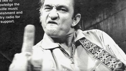 The True Story Behind Johnny Cash's Famous Middle Finger Photo | Country Music Videos