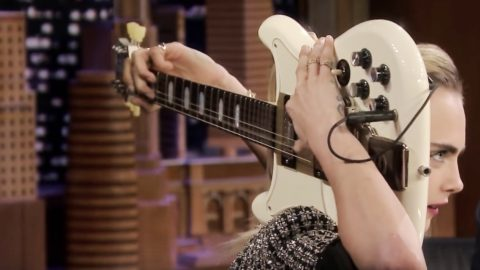 Cara Delevingne Plays 'Sweet Home Alabama' Riff On Guitar Behind Her Head | Country Music Videos