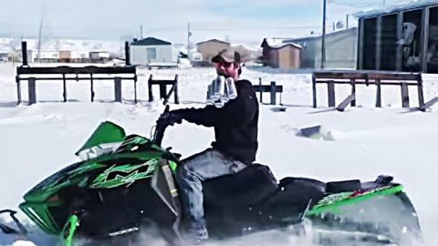Snowed-In Man Heads For Beer On His Snowmobile | Country Music Videos