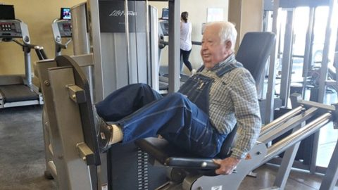 "91-Year-Old Works Out At Gym In Denim Overalls – Encourages Others To ""Get Started"" 